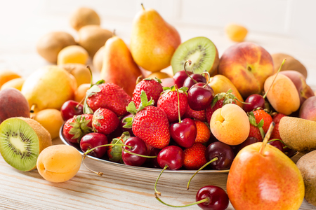 mixed fruits: Fresh mixed fruits and berries on plate. Healthy eating, dieting. Summer food, clean eating