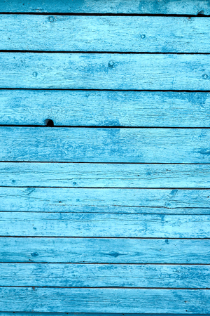 blemished: Old wooden boards of a background with the cracked paint. Painted blue color