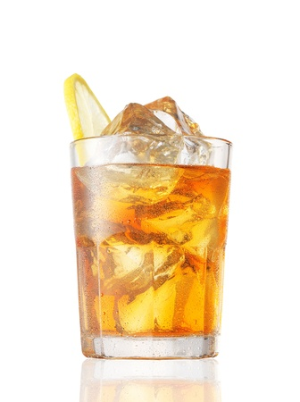 A glass of Ice Tea with a lemon slice on white. Stock Photo