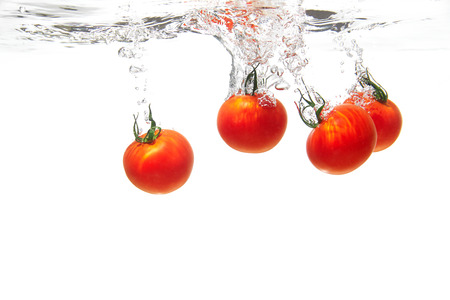 the tomato under the water