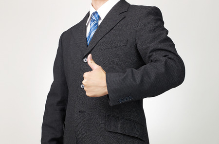 businessman thumbs up gesture Stock Photo