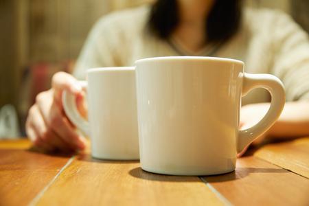 the coffee mug on the table