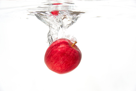 the apple under the water
