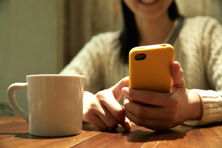 Asian woman using the smartphone, no face