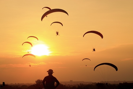 Paramotor Silhouette in sunset  photo
