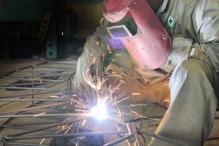 Industrial worker make a spark welding  photo