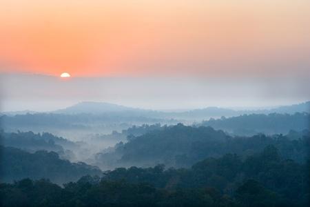 sun rise over a fog and mountain  photo