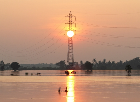 High voltage tower, sun set , flood  photo