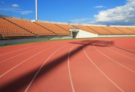 race track: Run race track in sport stadium ,Spot light shadow Stock Photo