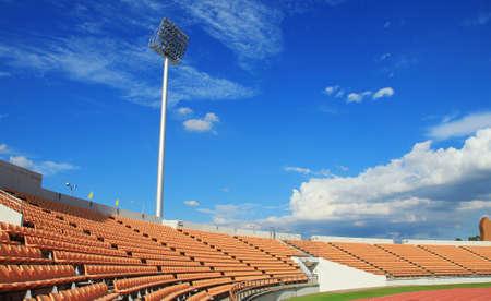 baseball stadium: Orange seat,spot light tower , blue backgrouc