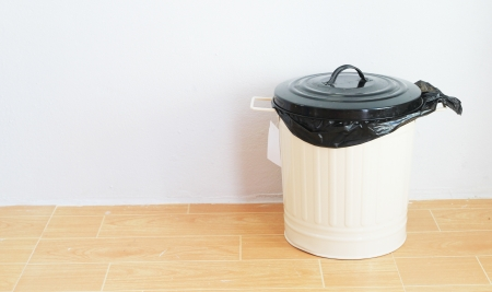 a black plastic bag in reuse disposal bin photo