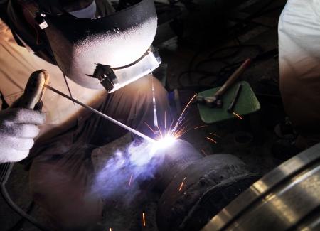 sparking: industrial worker welding sparking