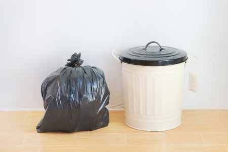 disposal: a black plastic bag and reuse disposal bin  Stock Photo