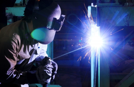 metal structure: Industrial worker make a spark by welding