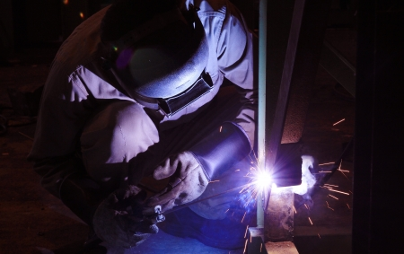 Industrial worker make a spark by welding Stock Photo - 20096785