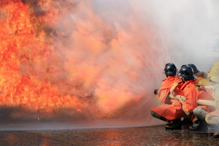 firefighter: Firefighters fighting fire during training