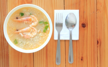 Thai Rice Soup With Shrimp ,Khao Tom Goong.wood background photo