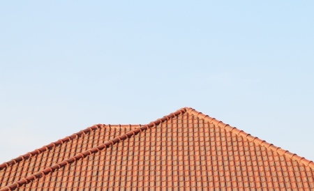 roofing: Brown roof, blue sky background Stock Photo