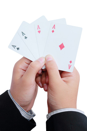 business man showing a four of aces photo