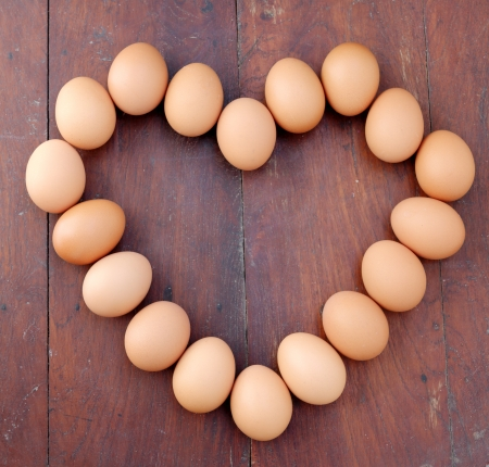 eggs, heart shape, wood background  Stock Photo