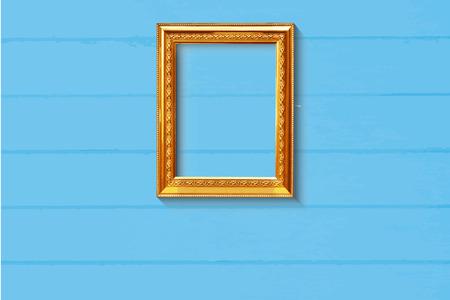 gold picture frame: Old style golden picture frame on light blue wood background Illustration