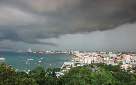 Storm clouds and rain over Pattaya Sea beach city Thailand
