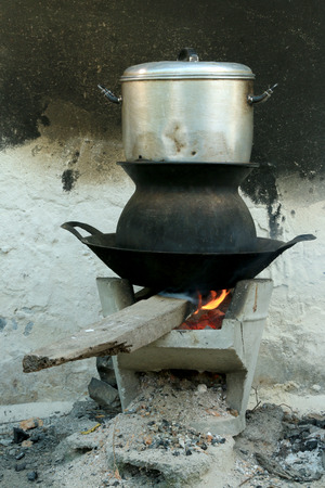 Old style, Boil steam pot on bon fire stove photo
