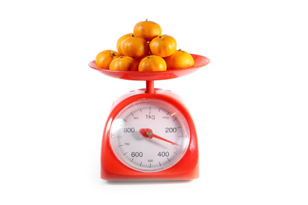 weighing scale: Orange on red weighing scale, isolate on white background