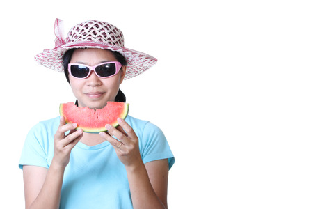 Woman in straw hat against white background hold a slice of watermelon. photo
