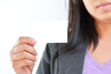 White blank card, Business woman holding card that can be replace with namecard,sign etc. photo