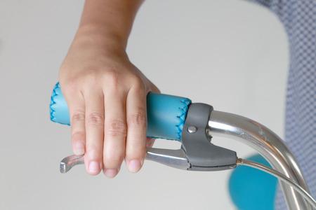 Woman hand pushing brake lever, Close up.