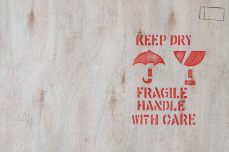 handle with care: keep dry, fragile,handle with care ,Packing sign on wood background.