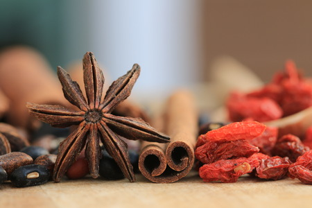 Nuts and chinese herb on wood background.