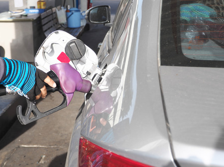 refilling: Refilling fuel to car on a gas filling station. Stock Photo