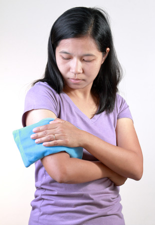 thermotherapy: Arm cold or Hot Therapy Woman. Stock Photo