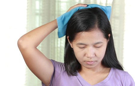 Head cold or Hot Therapy Woman. 版權商用圖片