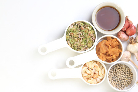 coconut sugar: Dries chili, pepper,lemongrass,garlic,Coconut sugar and fish sauce, Thai herbs on white background. Stock Photo