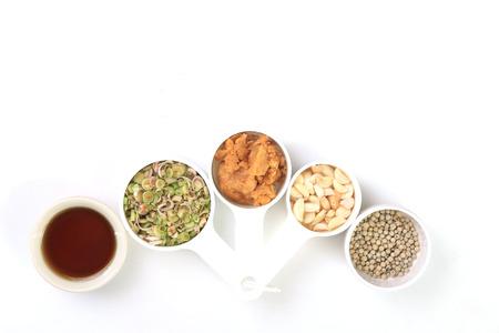 coconut sugar: Dries chilli, pepper,lemongrass,garlic,Coconut sugar and fish sauce, Thai herbs on white background.