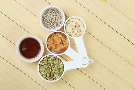 coconut sugar: pepper,lemongrass,garlic,Coconut sugar and fish sauce, Thai herbs on wood floor