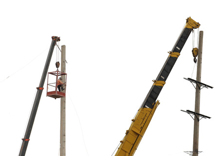 lineman: Work with electricity post and crane,isolated on white background. Stock Photo