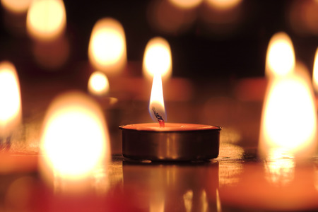 candle light: Candles light select focus, black background.