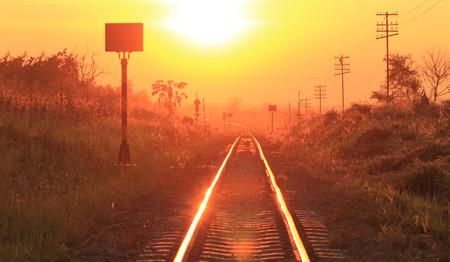 sun track: Railways track in trains against beautiful light of sun set sky