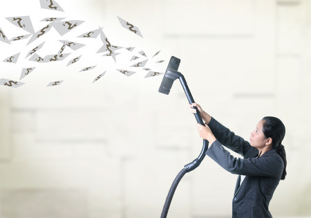 air cleaner: Business woman pull some thing from air by vacuum cleaner.