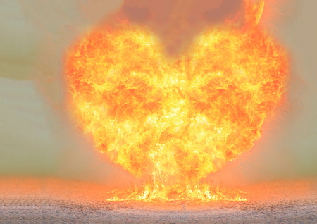 heart burn: Blazing fire bright flamy heart shape symbol. Stock Photo