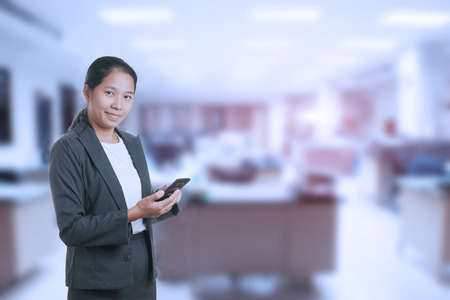 office environment: Portrait of a smart business woman in an office environment