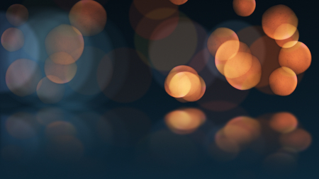 bokeh or defocus orange particles and reflection. abstract background.