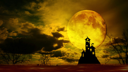 Dark castle with dramatic sky, tree, full moon and clouds, Warm orange tone. Stock Photo