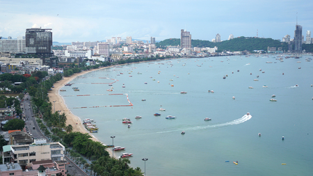Aerial top view. Many sailing, motor, speed boats, Sailing ships, sailboats at Pattaya city, Thailand.