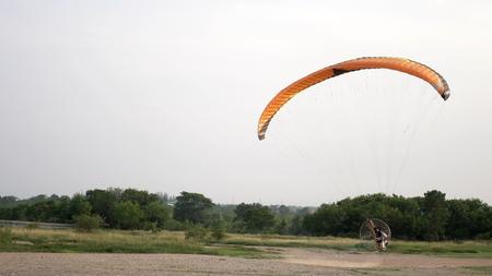 Paramotor start and flying Stock Photo