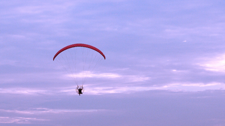 Parachute or paramotor fly in sunset, sport activity Stock Photo